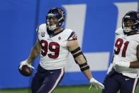 Houston Texans defensive end J.J. Watt (99) runs into the end zone for a touchdown after incepting a pass intended for Detroit Lions fullback Jason Cabinda during the first half of an NFL football game, Thursday, Nov. 26, 2020, in Detroit. (AP Photo/Duane Burleson)