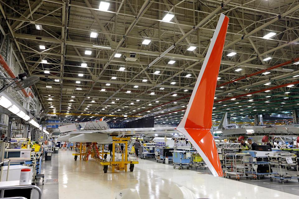 Boeing 737 MAX winglets, which sweep up and down from the wingtip and differ from the current 737 model with its single upward wingtip sweep, stand already painted in the Lion Air livery as the wing is assembled at Boeing's airplane production facility Monday, Feb. 13, 2017, in Renton, Wash. Boeing plans to deliver its first 737 MAX airplane by May. Boeing's latest innovations inside its Renton factory includes new robotic machines as well as more efficient ways of deploying its mechanics. The company is also increasing its 737 production rate to 47 per month, from 42. (AP Photo/Elaine Thompson)