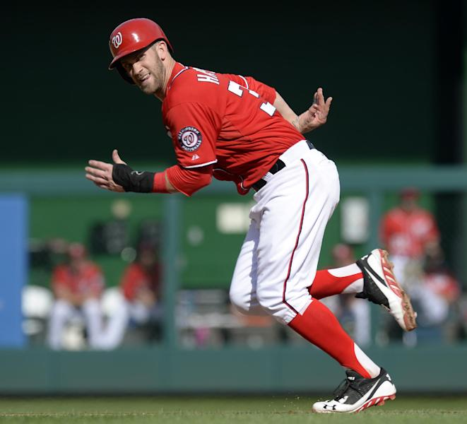 Washington Nationals' Bryce Harper runs and steals second base during the seventh inning of their baseball game against the Philadelphia Phillies at Nationals Park in Washington, Sunday, Sept. 15, 2013. The Nationals won 11-2. Harper and teammate Jayson Werth both stole bases on the play. (AP Photo/Susan Walsh)