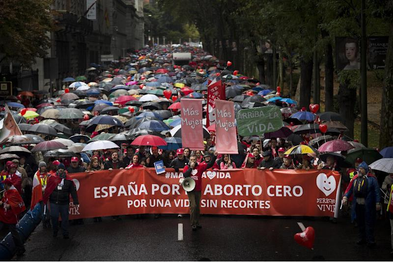 Demonstrators hold a banner reading 'Spain zero abortion, a life with our cuts, right to live' as they march shouting against abortion in Madrid, Spain, Sunday, Oct. 17, 2013. (AP Photo/Daniel Ochoa de Olza)