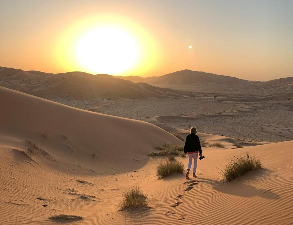 Shoes go first: A fellow member of the tour group stretches her toes in the desert sand  (Mark Jones)