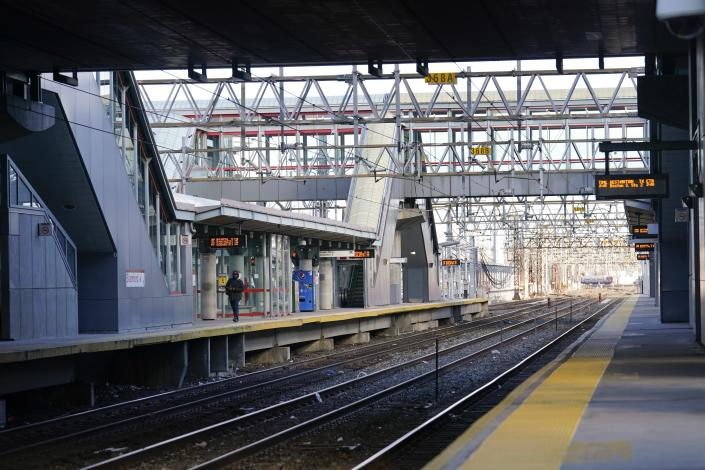 A man walks the Stamford Metro North train station Tuesday, Dec. 29, 2020, in Stamford, Conn. With many New Yorkers moving to neighboring Connecticut during the pandemic, especially Fairfield County, it's becoming more challenging for people to find affordable homes to buy. (AP Photo/Frank Franklin II)