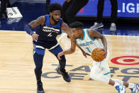Charlotte Hornets' Malik Monk (1) drives around Minnesota Timberwolves' Jaylen Nowell (4) during the first half of an NBA basketball game Wednesday, March 3, 2021, in Minneapolis. (AP Photo/Jim Mone)
