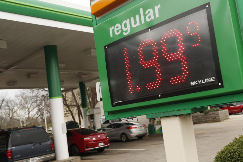 FILE - In this Tuesday, Jan. 8, 2019, file photo drivers fill up at the BP station on Prince Avenue in Athens, Ga. The average U.S. price of regular-grade gasoline has dropped 12 cents a gallon (3.8 liters) over the past three weeks to $2.31. Industry analyst Trilby Lundberg of the Lundberg Survey says Sunday, Jan. 13, that falling crude oil costs are the main reason for the decrease at the pump. The average gas price has dropped 66 cents over the past 3 ½ months. The highest average price in the nation is $3.46 a gallon in the San Francisco Bay Area. The lowest average is $1.80 in Baton Rouge, Louisiana. (Joshua L. Jones/Athens Banner-Herald via AP, File)