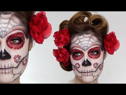 """<p>Sugar skulls continue to get all the love on Halloween, so why not jump on the bandwagon with this tutorial that (be)dazzles!</p><p><a class=""""link rapid-noclick-resp"""" href=""""https://www.amazon.com/s?k=flat+sticky+back+red+crystals&ref=nb_sb_noss&tag=syn-yahoo-20&ascsubtag=%5Bartid%7C10050.g.34087783%5Bsrc%7Cyahoo-us"""" rel=""""nofollow noopener"""" target=""""_blank"""" data-ylk=""""slk:SHOP RED CRAFT CRYSTALS"""">SHOP RED CRAFT CRYSTALS</a></p><p><a href=""""https://www.youtube.com/watch?v=yhfKJCYTcJs"""" rel=""""nofollow noopener"""" target=""""_blank"""" data-ylk=""""slk:See the original post on Youtube"""" class=""""link rapid-noclick-resp"""">See the original post on Youtube</a></p>"""