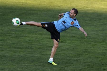 Spain's national soccer player Andres Iniesta takes part in a training session at Soccer City in Las Rozas