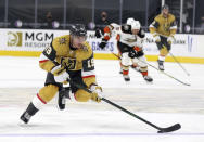 Vegas Golden Knights right wing Reilly Smith (19) skates with the puck down the ice during the second period of the team's NHL hockey game against the Anaheim Ducks on Saturday, Jan. 16, 2021, in Las Vegas. (AP Photo/Isaac Brekken)