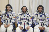 In this handout photo released by Roscosmos, Actress Yulia Peresild, left, director Klim Shipenko' right, and cosmonaut Anton Shkaplerov, members of the prime crew of Soyuz MS-19 spaceship pose at the Russian launch facility in the Baikonur Cosmodrome, Kazakhstan, Sunday, Sept. 19, 2021. In a historic first, Russia is set to launch an actress and a film director to space to make a feature film in orbit. Actress Yulia Peresild and director Klim Shipenko are set to blast off Tuesday for the International Space Station in a Russian Soyuz spacecraft together with Anton Shkaplerov, a veteran of three space missions. (Roscosmos Space Agency via AP)
