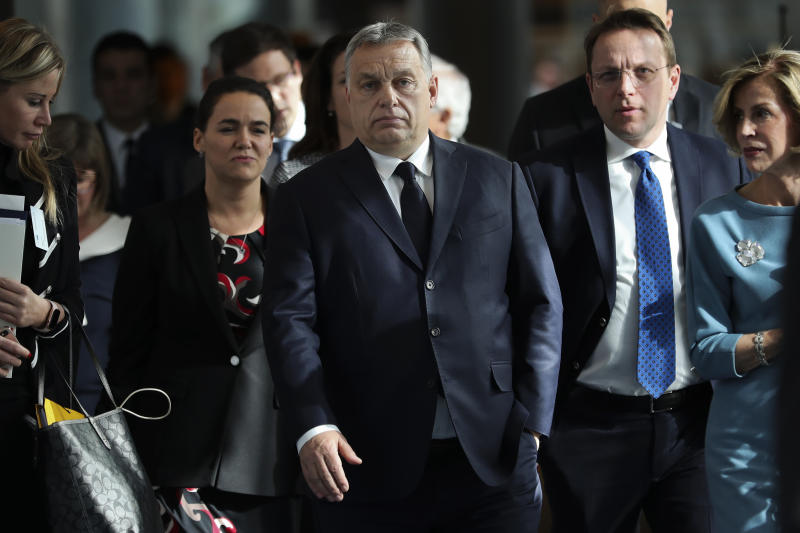 Hungarian Prime Minister Viktor Orban, center, arrives to an European People's Party's meeting at the European Parliament in Brussels, Wednesday, March 20, 2019. Hungary's ruling Fidesz party will immediately leave the main center-right alliance in the European Parliament if the group votes to suspend it, the Hungarian prime minister's chief of staff said Wednesday. (AP Photo/Francisco Seco)