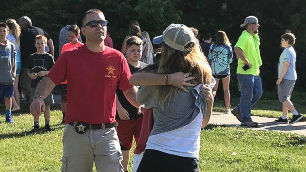 PHOTO: People hug after a shooting at Noblesville West Middle Scholl in Noblesville, Ind., May 25, 2018. (Chris Sikich/IndyStar via USA Today Network)
