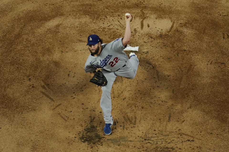 Los Angeles Dodgers starting pitcher Clayton Kershaw throws against the Tampa Bay Rays during the first inning in Game 5 of the baseball World Series Sunday, Oct. 25, 2020, in Arlington, Texas. (AP Photo/David J. Phillip)