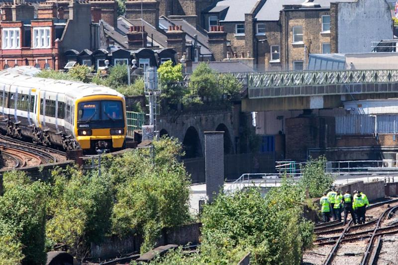 Police search the tracks where three people were killed by a moving train near Brixton and Loughborough Junction (Alex Lentati)