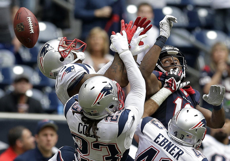 New England Patriots defenders Aqib Talib, left, Marquice Cole (23) and Nate Ebner (43) break up a pass intended for Houston Texans' DeAndre Hopkins, upper right, during the fourth quarter of an NFL football game on Sunday, Dec. 1, 2013, in Houston. (AP Photo/Patric Schneider)