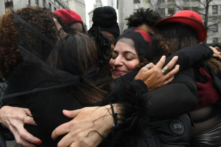 NEW YORK, NY - JANUARY 10 : Women inspired by the Chilean feminist group called Las Tesis hug after performing a protest song in front of the New York City criminal court during Harvey Weinstein's sex crimes trial on January 10, 2020 in New York City. Weinstein, a movie producer whose alleged sexual misconduct helped spark the #MeToo movement, pleaded not-guilty on five counts of rape and sexual assault against two unnamed women and faces a possible life sentence in prison. Stephanie Keith/Getty Images/AFPNEW YORK, NY - JANUARY 10 : Women inspired by the Chilean feminist group called Las Tesis hug after performing a protest song in front of the New York City criminal court during Harvey Weinstein's sex crimes trial on January 10, 2020 in New York City. Weinstein, a movie producer whose alleged sexual misconduct helped spark the #MeToo movement, pleaded not-guilty on five counts of rape and sexual assault against two unnamed women and faces a possible life sentence in prison. Stephanie Keith/Getty Images/AFP
