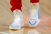 Atlanta Hawks guard Trae Young's (11) shoes honors Kobe Bryant prior to an NBA basketball game against the Washington Wizards on Sunday, Jan. 26, 2020, in Atlanta. Bryant died in a helicopter crash Sunday. (AP Photo/Todd Kirkland)