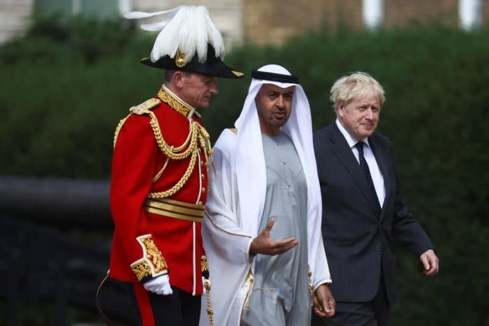 Boris Johnson and the Crown Prince of Abu Dhabi inspect the Guard of Honour in London