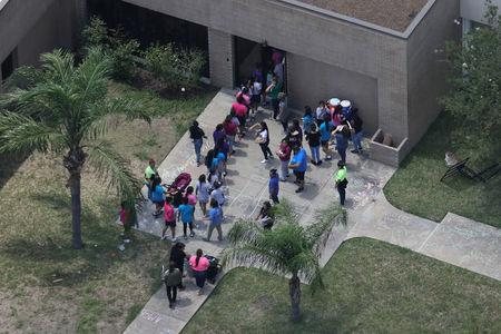 Migrant children make their way inside a building at Casa Presidente, an immigrant shelter for unaccompanied minors, in Brownsville