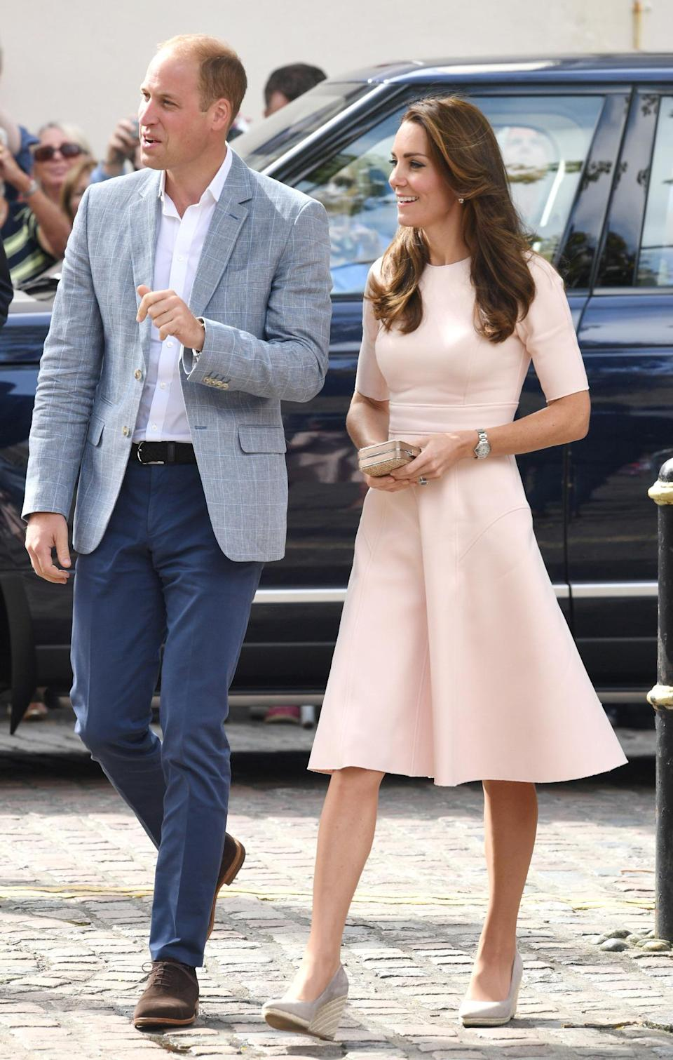 <p>Looking lovely in pink, the Duchess of Cambridge began an away day in Cornwall with Prince William with a visit to Truro Cathedral. For the occasion, the 34-year-old donned a simple dress by US designer Lela Rose, which costs around £1000. Kate paired the dress with her go-to Monsoon dove grey wedges and carried a box clutch. </p><p><i>[Photo: Rex Features]</i><br></p>