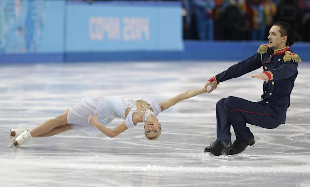 Tatiana Volosozhar and Maxim Trankov of Russia compete in the pairs short program figure skating competition at the Iceberg Skating Palace during the 2014 Winter Olympics, Tuesday, Feb. 11, 2014, in Sochi, Russia. (AP Photo/Darron Cummings)
