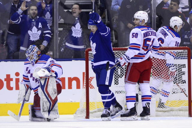 Toronto Maple Leafs right wing Mitchell Marner (16) celebrates Morgan Rielly's goal against New York Rangers goaltender Alexandar Georgiev (40) during the third period of an NHL hockey game Saturday, Dec. 22, 2018, in Toronto. (Frank Gunn/The Canadian Press via AP)