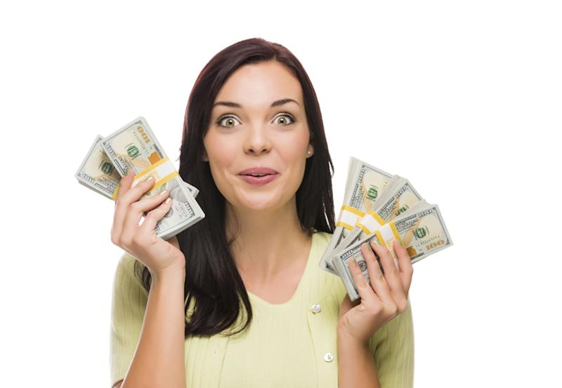 Happy woman with cash in both hands.