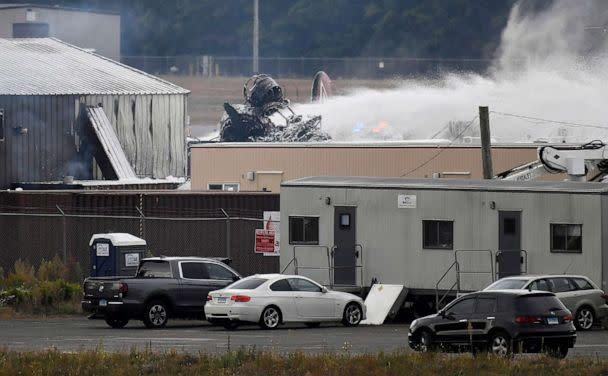 PHOTO: A fire-and-rescue operation is underway where World War II-era bomber plane crashed at Bradley International Airport in Windsor Locks, Conn., Wednesday, Oct. 2, 2019. (Jessica Hill/AP)