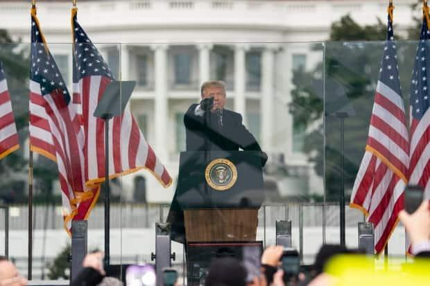 U.S. President Donald Trump fires up his supporters at a rally near the White House on Jan. 6 while lawmakers at the Capitol were in the process of certifying the results of the presidential election he lost. (Evan Vucci/The Associated Press - image credit)