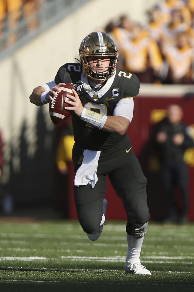 Minnesota quarterback Tanner Morgan (2) runs with the ball during an NCAA college football game against Maryland, Saturday, Oct. 26, 2019, in Minneapolis. (AP Photo/Stacy Bengs)