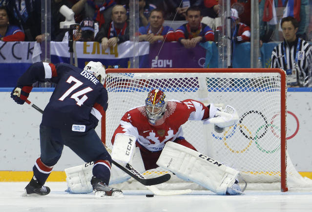 USA forward T.J. Oshie prepares to take a shot against Russia goaltender Sergei Bobrovsky during a shootout in a men's ice hockey game at the 2014 Winter Olympics, Saturday, Feb. 15, 2014, in Sochi, Russia. Oshie scored the winning goal and the USA won 3-2. (AP Photo/Mark Humphrey)