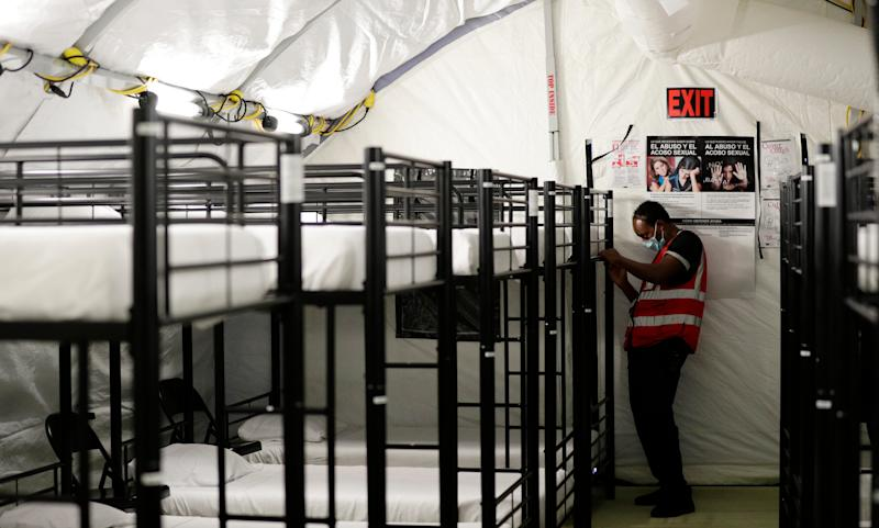 A staff member works in the infirmary, a series of tents, at the U.S. government's newest holding center for migrant children in Carrizo Springs, Texas.