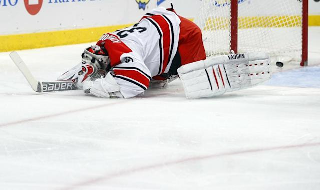 Carolina Hurricanes goalie Anton Khudobin reacts after giving up a goal against the Chicago Blackhawks during the second period of an NHL hockey game in Chicago, Friday, March 21, 2014. (AP Photo/Jeff Haynes)
