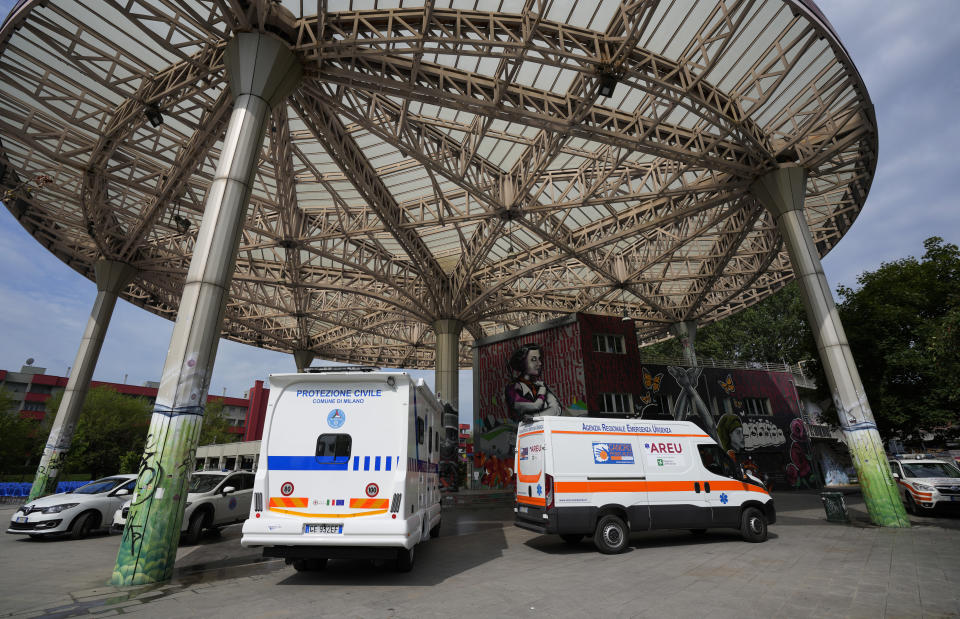 Camper vans are parked outside a cultural center on the outskirts of Milan, Italy, Wednesday, July 28, 2021, where people can receive the Johnson & Johnson vaccine for COVID-19. A camper van will tour Milan and the Lombardy region to provide easy vaccinations without bookings in an attempt to boost the vaccination campaign. Europe's famed summer holiday season is in full swing, but efforts to inoculate people against coronavirus are not taking a break. From France's Mediterranean coast to Italy's Adriatic beaches, health authorities are trying to make a COVID-19 shot as much a part of this summer as sunscreen and shades. (AP Photo/Antonio Calanni)