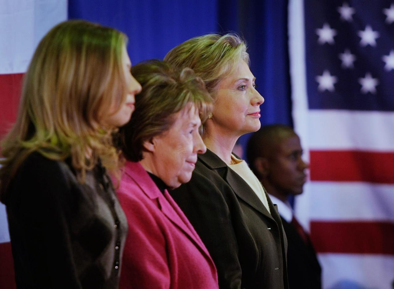 INDIANOLA, IA - FILE:  Democratic presidential candidate Sen. Hillary Clinton (D-NY) (2nd R) stands with her mother Dorothy Rodham (2nd L) and daughter Chelsea Clinton (L) during a campaign event at the First United Methodist Church January 2, 2008 in Indianola, Iowa. In a statement released by the Clinton Foundation, it was announced that Dorothy Rodham, 92, died shortly after midnight November 1, 2011 in Washington, DC. (Photo by Joe Raedle/Getty Images)