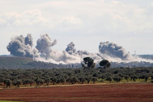 Smoke billowed over the village of Qaminas, southeast of Idlib, following reported Russian air strikes
