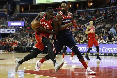 FILE PHOTO: Jan 13, 2019; Washington, DC, USA; Toronto Raptors forward Pascal Siakam (43) drives to the basket as Washington Wizards center Ian Mahinmi (28) defends in the second quarter at Capital One Arena. Mandatory Credit: Geoff Burke-USA TODAY Sports