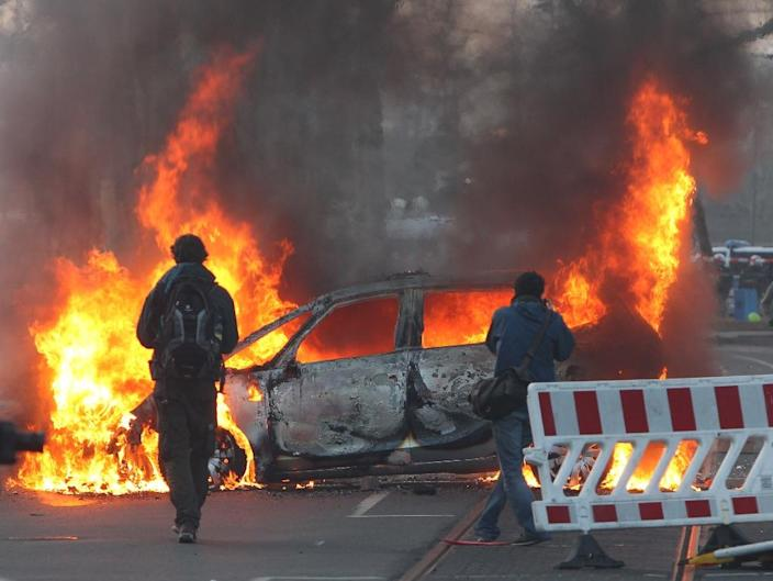 A police car was set on fire, windows were smashed and demonstrators threw stones at police in Frankfurt ahead of a massive anti-austerity rally marking the opening of the European Central Bank's new headquarters (AFP Photo/Daniel Roland)