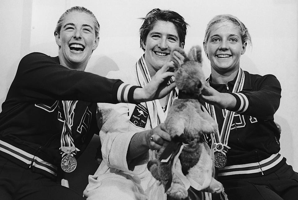 <p>The medalists of the 100 Meters Freestyle swimming event — silver medallist Sharon Stouder of the U.S.A., third-time gold medallist Dawn Fraser of Australia and bronze medallist Kathleen Ellis — pose with Fraser's lucky kangaroo mascot. </p>