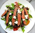"""<p>Tangy feta and Balsamic onions really take the steak.</p><p>Get the recipe from <a href=""""https://www.delish.com/cooking/recipe-ideas/recipes/a42996/grilled-skirt-steak-salad-arugula-balsamic-glazed-onions-tomatoes-feta/"""" rel=""""nofollow noopener"""" target=""""_blank"""" data-ylk=""""slk:Delish"""" class=""""link rapid-noclick-resp"""">Delish</a>.</p>"""
