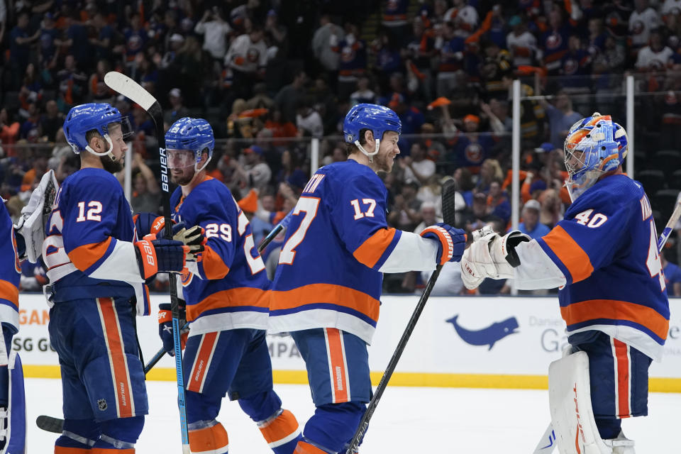 New York Islanders goaltender Semyon Varlamov (40) celebrates with teammates after Game 4 during an NHL hockey second-round playoff series against the Boston Bruins, Saturday, June 5, 2021, in Uniondale, N.Y. (AP Photo/Frank Franklin II)