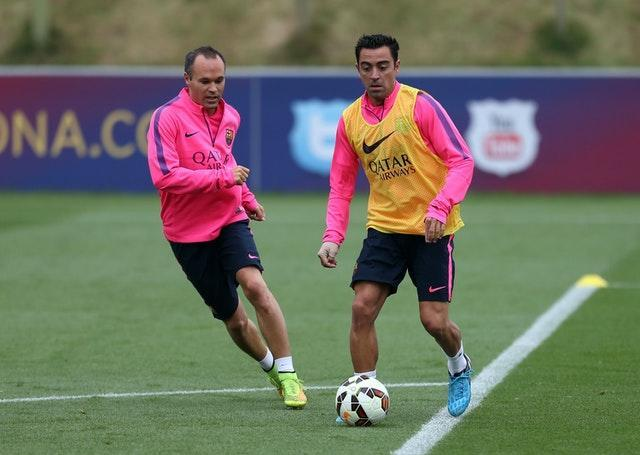 Font also wants the likes of Andres Iniesta, left, and Xavi to return to the club