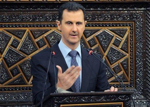<p>Picture released by the official Syrian Arab News Agency (SANA) shows Syrian President Bashar al-Assad addressing the parliament in Damascus on June 3, 2012.</p>