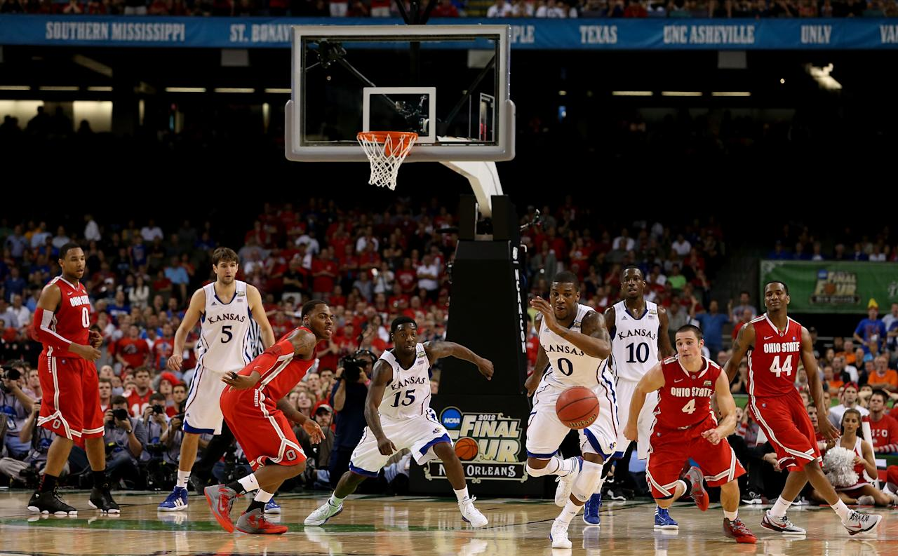 NEW ORLEANS, LA - MARCH 31:  Thomas Robinson #0 of the Kansas Jayhawks and Aaron Craft #4 of the Ohio State Buckeyes go after a loose ball in the second half during the National Semifinal game of the 2012 NCAA Division I Men's Basketball Championship at the Mercedes-Benz Superdome on March 31, 2012 in New Orleans, Louisiana.  (Photo by Jeff Gross/Getty Images)