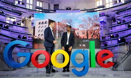 FILE PHOTO: Google CEO Sundar Pichai and Philipp Justus, Google Vice President for Central Europe and the German-speaking Countries, stand by a Google logo during the opening of the new Alphabet's Google Berlin office in Berlin, Germany, January 22, 2019. REUTERS/Hannibal Hanschke /File Photo