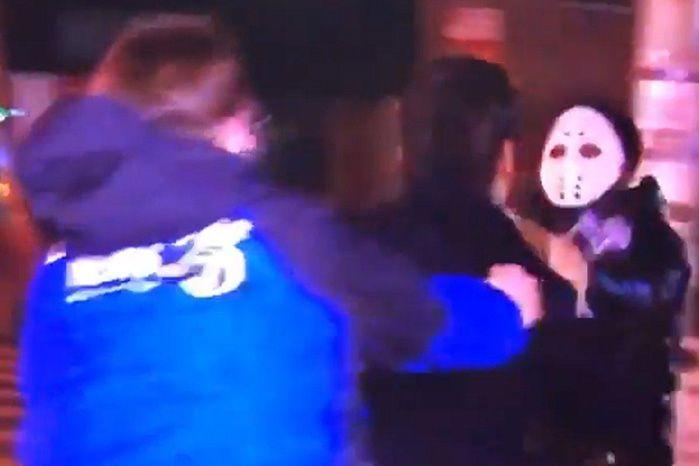The TV presenter was floored momentarily after the masked man threw a right hook to his head. Source: Facebook