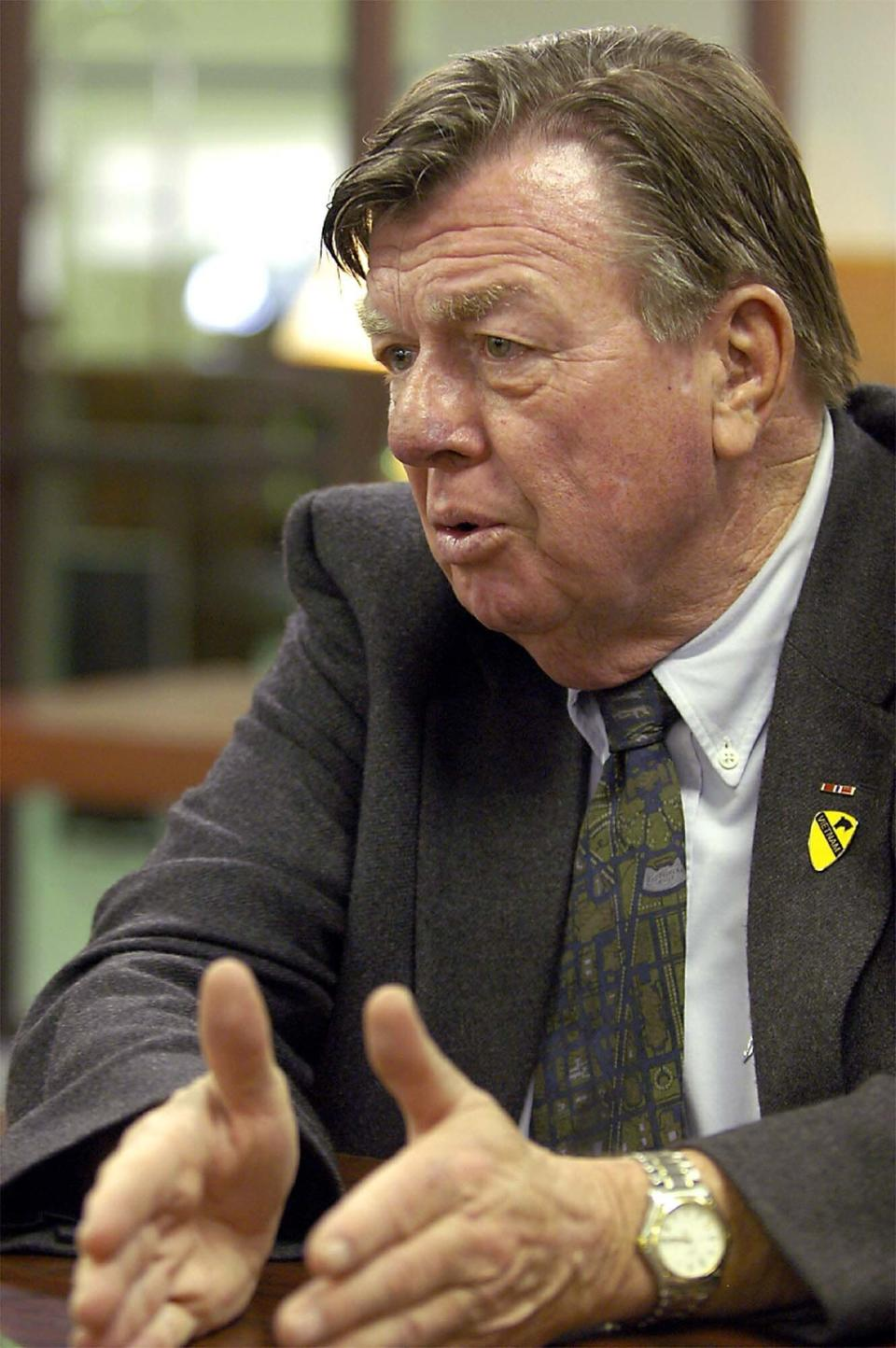 """FILE- Joe Galloway, war correspondant and co-author of """"We Were Soldiers Once ... and Young, speaks during an appearance at the New Mexico Military Institute in Roswell, N.M., on Feb. 6, 2004. Galloway, best known for his book recounting a pivotal battle in the Vietnam War that was made into a Hollywood movie, has died. He was 79. His wife, Grace Galloway, confirmed to AP that he died Wednesday morning after being hospitalized near their home in North Carolina. (Andrew Poertner/Roswell Daily Record via AP)"""