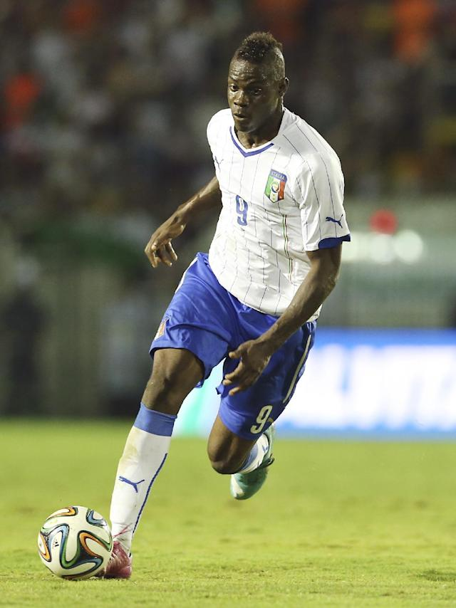 Italy's national soccer team player Mario Balotelli controls the ball during a World Cup warm up soccer match between Italy and Fluminense at the Cidadania stadium, in Volta Redonda, Brazil, Sunday, June 8, 2014. Italy plays in group D of the 2014 soccer World Cup. (AP Photo/Antonio Calanni)