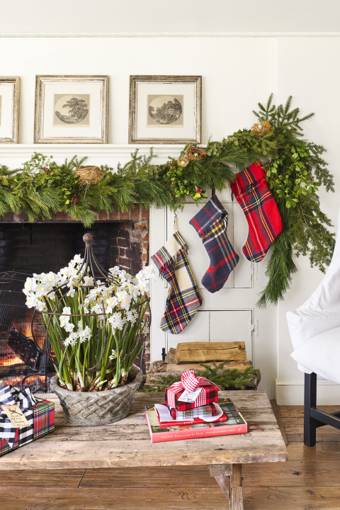 """<p>Garland is the perfect accessory for every room in your home during the holidays. Case in point: <a href=""""https://www.countryliving.com/home-design/house-tours/g4928/christmas-in-connecticut/"""" rel=""""nofollow noopener"""" target=""""_blank"""" data-ylk=""""slk:The mantel of this home"""" class=""""link rapid-noclick-resp"""">The mantel of this home</a> is outfitted with a garland of fresh pine, cedar, and holly.</p><p><a class=""""link rapid-noclick-resp"""" href=""""https://www.amazon.com/s/ref=nb_sb_noss?url=search-alias%3Dgarden&field-keywords=christmas+garland&tag=syn-yahoo-20&ascsubtag=%5Bartid%7C10050.g.1247%5Bsrc%7Cyahoo-us"""" rel=""""nofollow noopener"""" target=""""_blank"""" data-ylk=""""slk:SHOP GARLAND"""">SHOP GARLAND</a><br></p>"""