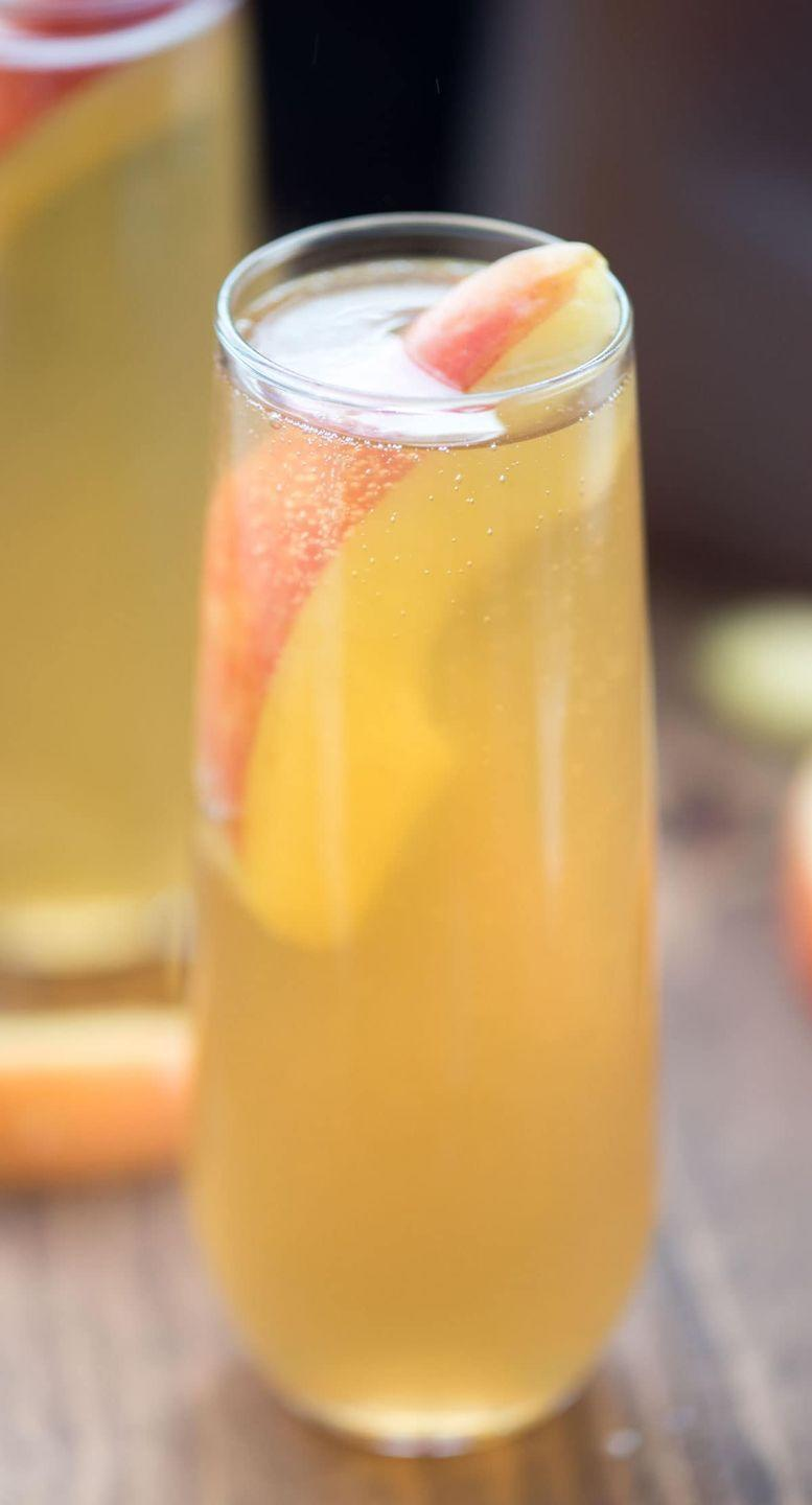 """<p>Put the finishing touch on a fall-inspired brunch with this fruity cider Bellini. </p><p><strong>Get the recipe at <a href=""""https://www.crazyforcrust.com/apple-cider-bellini/"""" rel=""""nofollow noopener"""" target=""""_blank"""" data-ylk=""""slk:Crazy for Crust"""" class=""""link rapid-noclick-resp"""">Crazy for Crust</a>.</strong></p><p><strong><a class=""""link rapid-noclick-resp"""" href=""""https://go.redirectingat.com?id=74968X1596630&url=https%3A%2F%2Fwww.walmart.com%2Fbrowse%2Fdining-entertaining%2Fdrinkware%2F4044_623679_639999_3148543%3Ffacet%3Dbrand%253AThe%2BPioneer%2BWoman&sref=https%3A%2F%2Fwww.thepioneerwoman.com%2Ffood-cooking%2Fmeals-menus%2Fg33510531%2Ffall-cocktail-recipes%2F"""" rel=""""nofollow noopener"""" target=""""_blank"""" data-ylk=""""slk:SHOP DRINKWARE"""">SHOP DRINKWARE</a><br></strong></p>"""