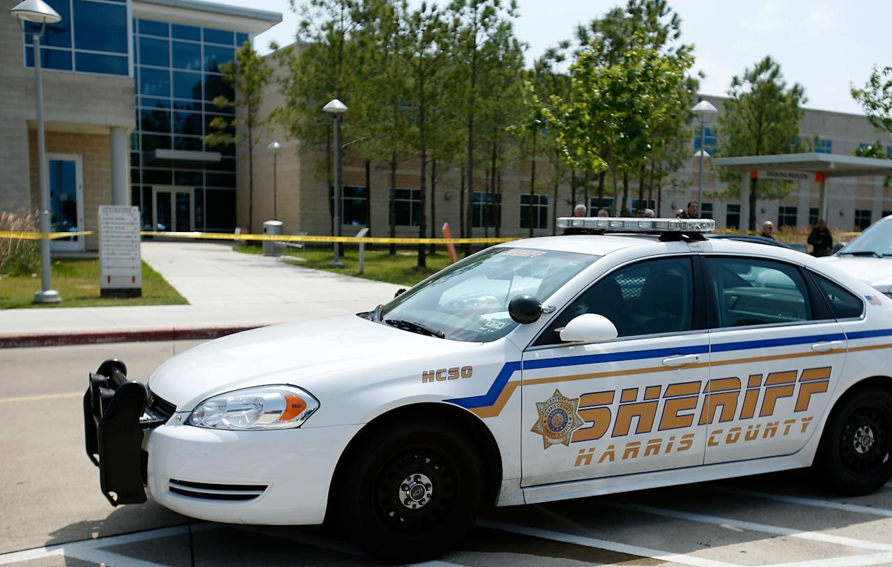 CYPRESS, TX - APRIL 09:  Harris County Sheriff officers seal off the campus after at least 14 people were injured in a stabbing incident at the Cy-Fair campus of Lone Star College on April 9, 2013 in Cypress, Texas. The community college located in northwest Houston was on lockdown until police detained a 21-year-old male student believed to be a suspect.  (Photo by Scott Halleran/Getty Images)