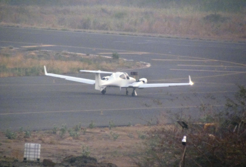 This photo released by Conflict Armament Research taken in Feb. 2017 is said by them to show a Diamond DA42 surveillance aircraft at the international airport in Juba, South Sudan. The Conflict Armament Research report released Thursday, Nov. 29, 2018, says Uganda diverted European weapons to South Sudan's military despite an EU arms embargo and asks how a U.S. military jet ended up deployed in South Sudan in possible violation of arms export controls. (Conflict Armament Research via AP)